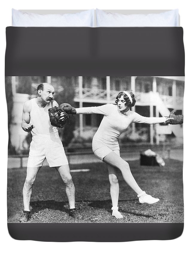 1035-1125 Duvet Cover featuring the photograph Martha Sleeper Winds Up by Pathe Photo