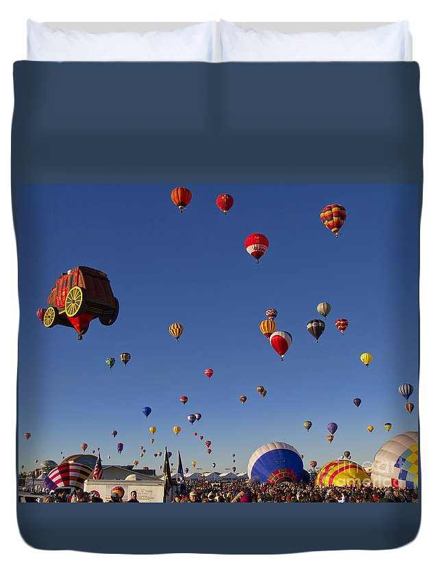 Mass Ascension Duvet Cover featuring the photograph Mass Ascension by Gary Holmes