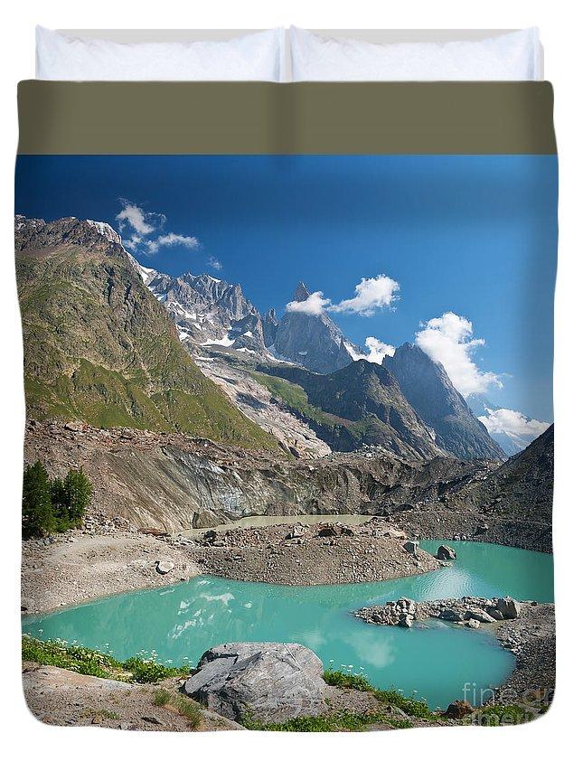 Alpine Duvet Cover featuring the photograph Miage Lake by Antonio Scarpi