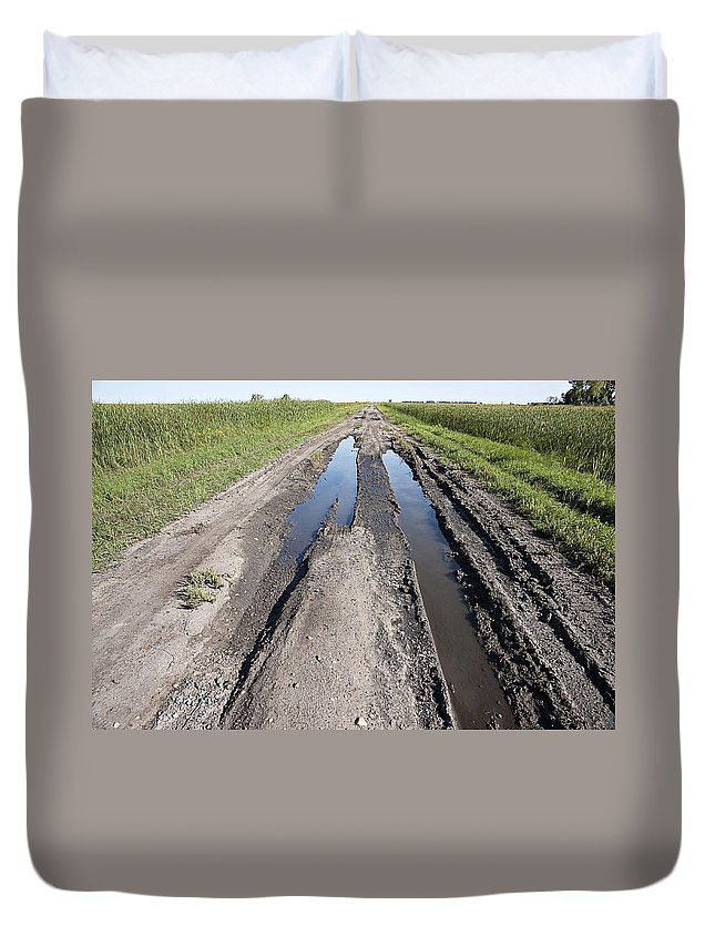 Road Duvet Cover featuring the photograph Muddy Country Road by Donald Erickson