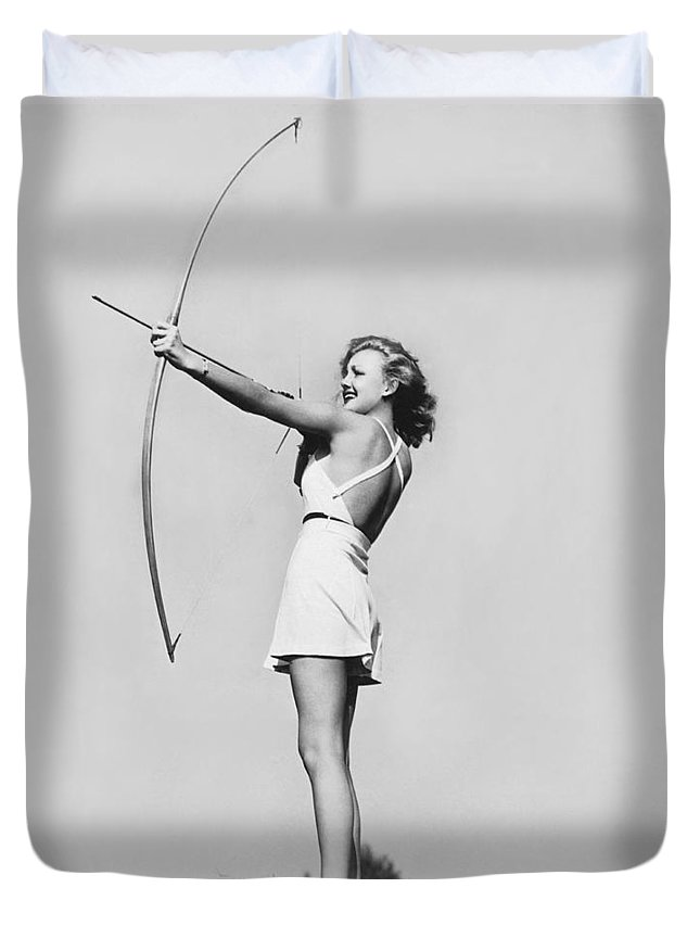1 Person Duvet Cover featuring the photograph New Fad Archery Golf by Underwood Archives