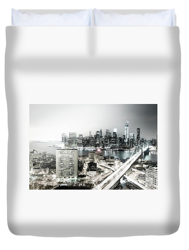 Lower Manhattan Duvet Cover featuring the photograph New York City Skyline At Night by Mundusimages