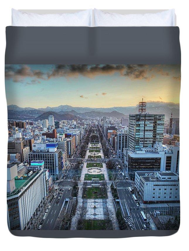 Hokkaido Duvet Cover featuring the photograph Odori Park Sunset by Daniel Chui
