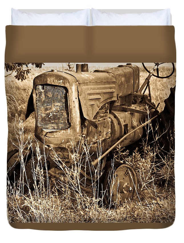 Old Duvet Cover featuring the photograph Old Farm Tractor In Sepia 1 by Douglas Barnett