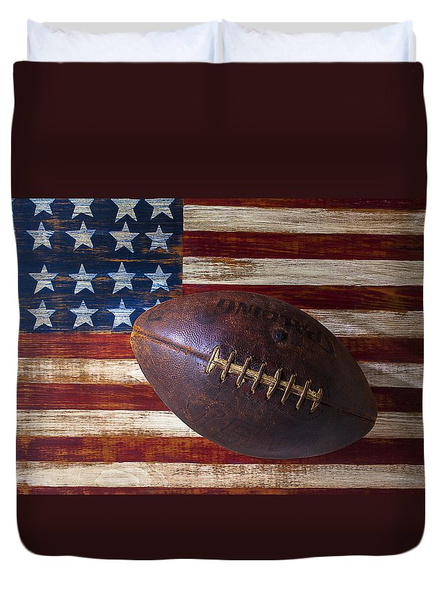 Football Duvet Cover featuring the photograph Old Football On American Flag by Garry Gay