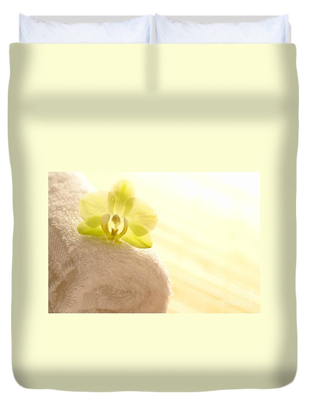 Orchid Duvet Cover featuring the photograph Orchid On Towel by Olivier Le Queinec