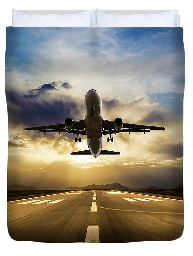 Taking Off Duvet Cover featuring the photograph Passenger Airplane Taking Off At Sunset by Guvendemir