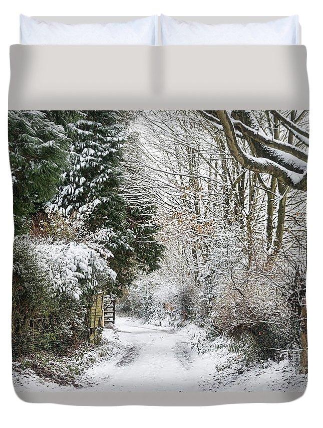 Snowy Path Duvet Cover featuring the photograph Path Through The Snow by Ann Garrett