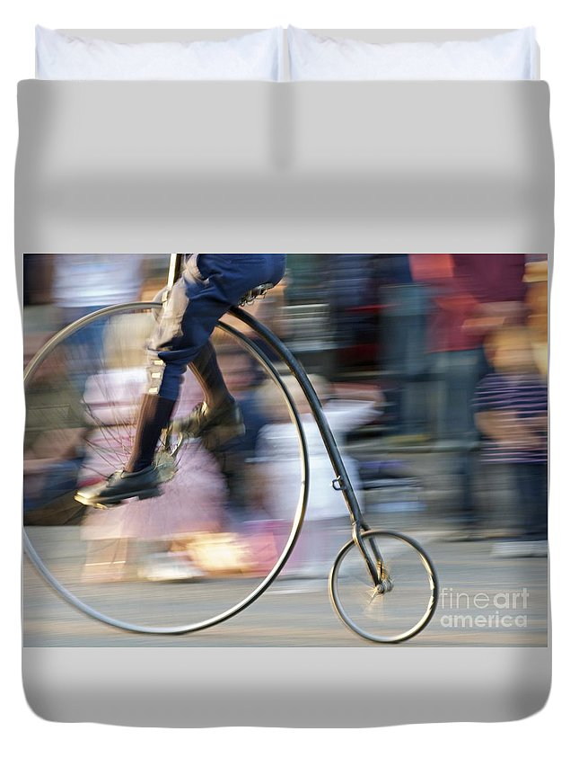 Bicycle Duvet Cover featuring the photograph Pedaling Past by Ann Horn