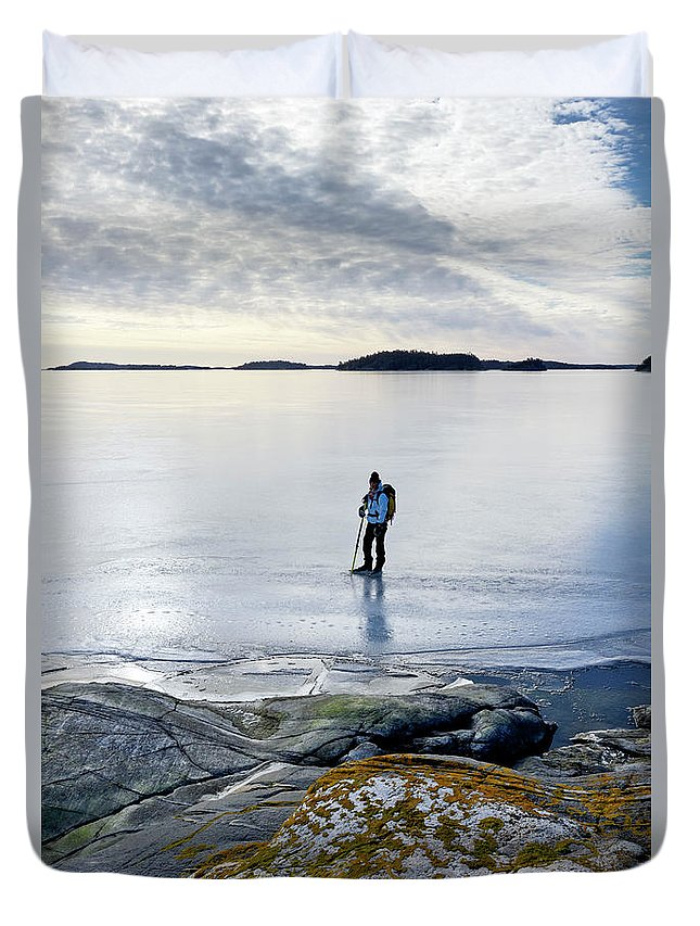 Archipelago Duvet Cover featuring the photograph Person Skating At Frozen Sea by Johner Images