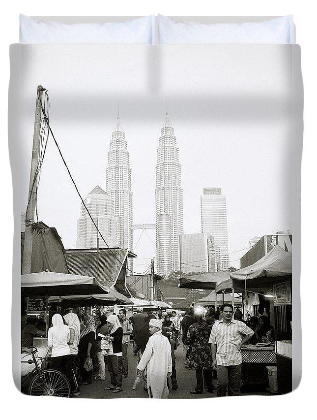 Kampung Baru Duvet Cover featuring the photograph Petronas Over Kampung Baru by Shaun Higson