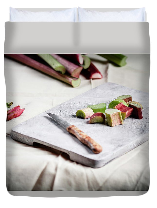 Cutting Board Duvet Cover featuring the photograph Pieces Of Rhubarb And Knife On Chopping by Westend61