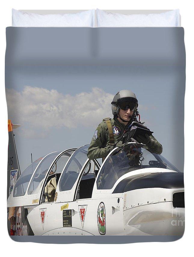 Aircraft Duvet Cover featuring the photograph Pilot Standing In A Socata Tb-30 by Timm Ziegenthaler