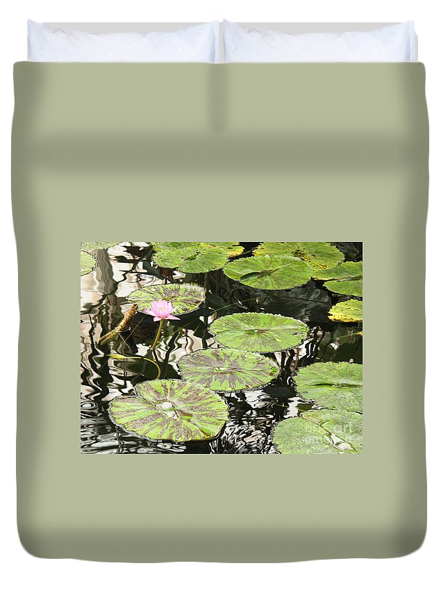 Pond Duvet Cover featuring the photograph One Pink Water Lily With Lily Pads by Carol Groenen