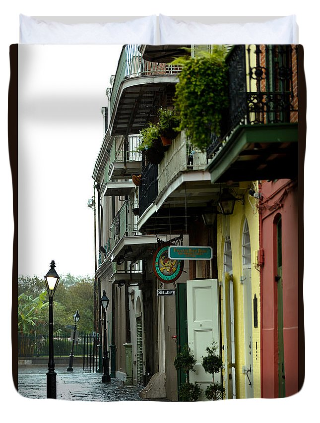 New Orleans Duvet Cover featuring the photograph Pirates Alley In The Rain by Susie Hoffpauir
