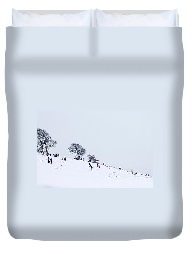 Children Duvet Cover featuring the photograph Playing In The Snow by Chris Smith
