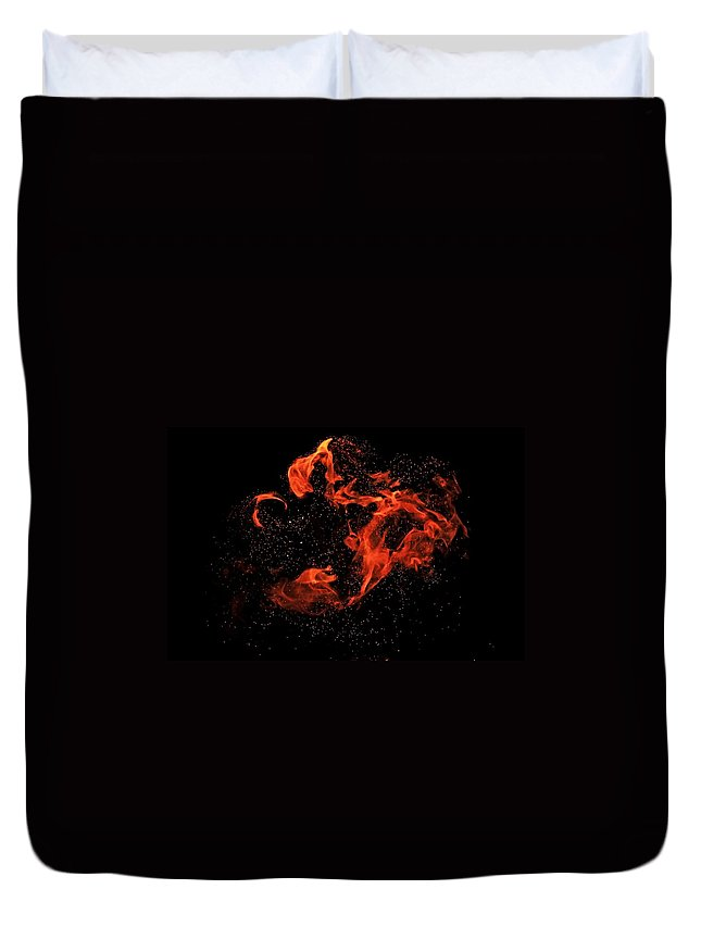 Abstract Duvet Cover featuring the photograph Playing With Fire by Michele Cornelius