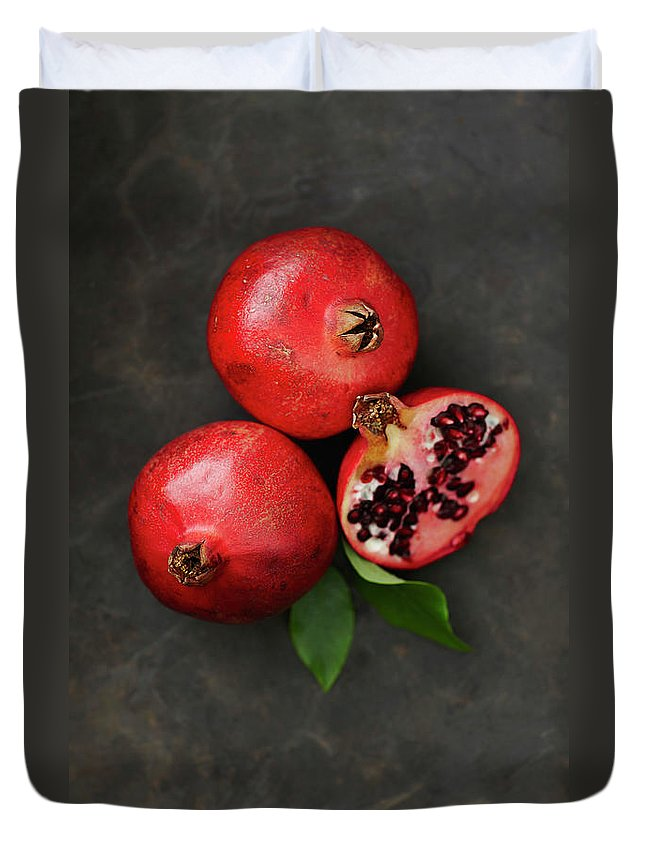 Pomegranate Duvet Cover featuring the photograph Pomegranates With Leaf, Close Up by Westend61