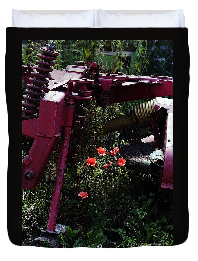 Poppy Papaver Rhoeas Poppies England English Farm Farming Duvet Cover featuring the photograph Poppies Growing Amongst Farm Machinery In A Farmyard Near Pocklington Yorkshire Wolds East Yorkshire by Michael Walters