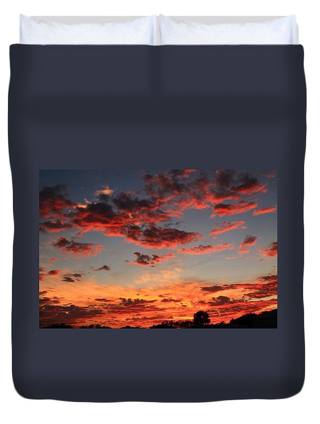 Sunset Duvet Cover featuring the photograph Puffy Pink Clouds by Catie Canetti