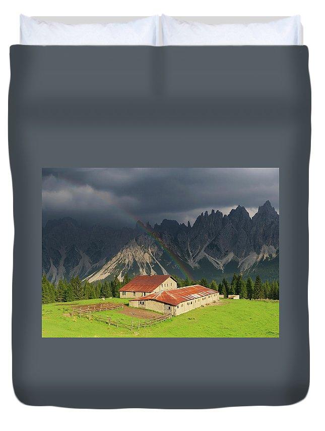 Belluno Duvet Cover featuring the photograph Rainbow Over Casera Vedorcia Dolomites by Albertosimonetti