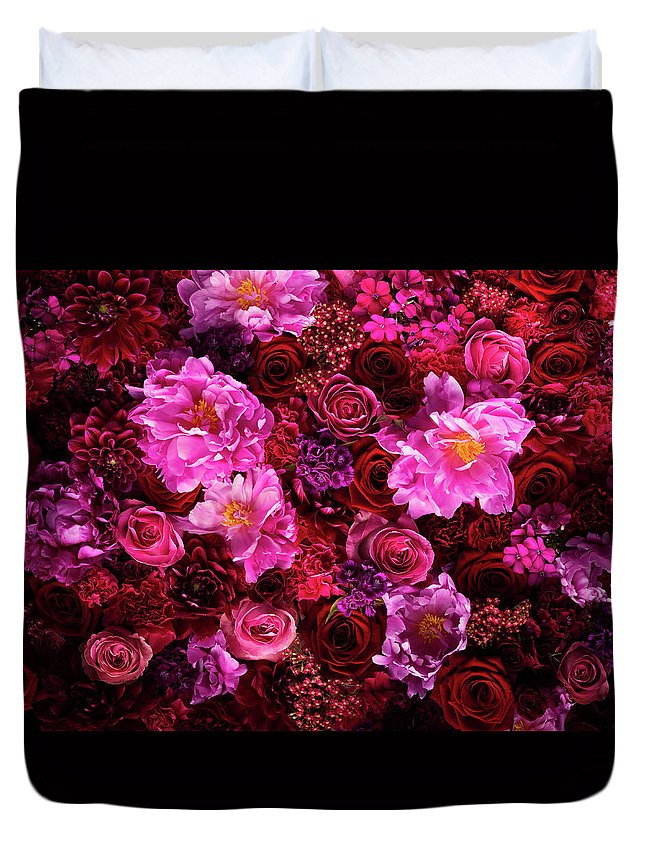 Tranquility Duvet Cover featuring the photograph Red And Pink Cut Flowers, Close Up by Jonathan Knowles