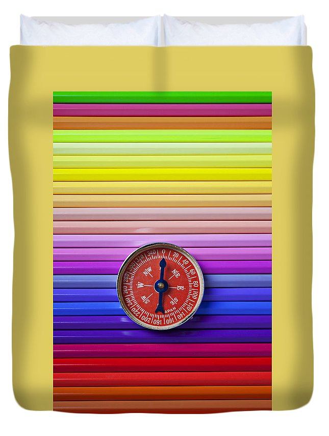 Red Duvet Cover featuring the photograph Red Compass On Rolls Of Colored Pencils by Garry Gay