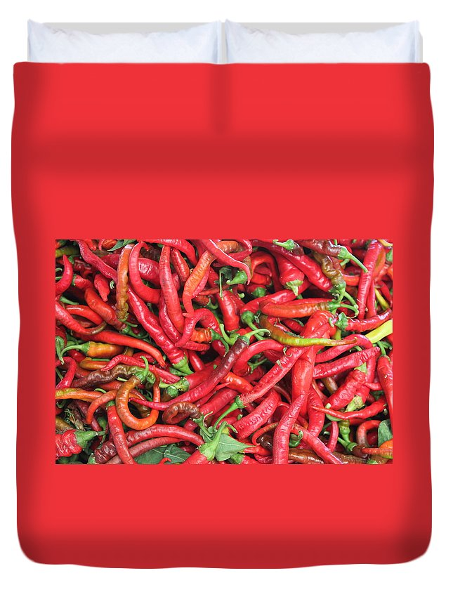 Still Life Duvet Cover featuring the photograph Red Hot Chilli Peppers by John Halliday