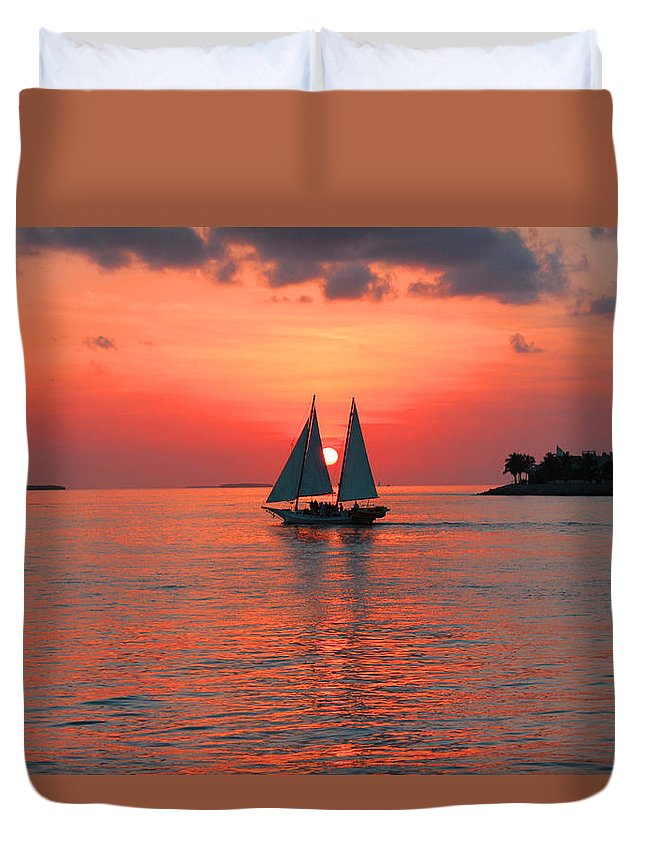 Sea Duvet Cover featuring the photograph Red Sunset by Iryna Goodall