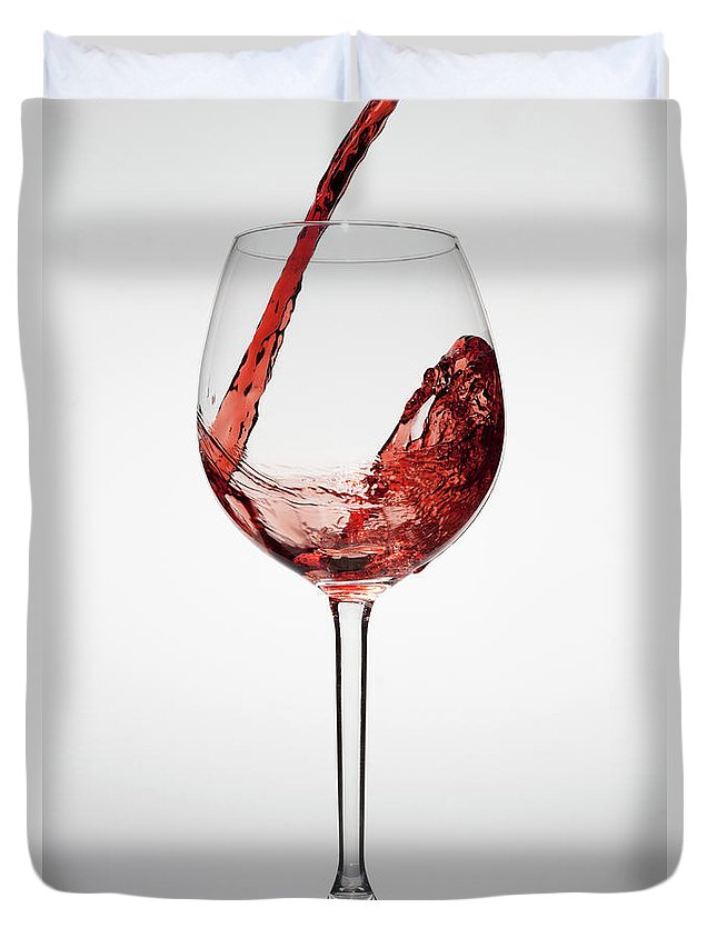Alcohol Duvet Cover featuring the photograph Red Wine Being Poured Into A Glass by Dual Dual