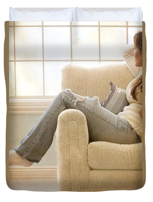 Woman; Lady; Female; Caucasian; Casual; Comfort; Comfortable; Lazy; Jeans; Socks; Sweater; Rips; Torn; Ripped; Hole; Chair; Sitting; Lounge; Lounging; Living Room; Indoors; Inside; Window; Wall; Carpet; Carpeting; Brunette; Crisp; Clean; Uncluttered; Sparse; Minimal; Alone; In Thought; Warm; Warmth Duvet Cover featuring the photograph Relaxed by Margie Hurwich