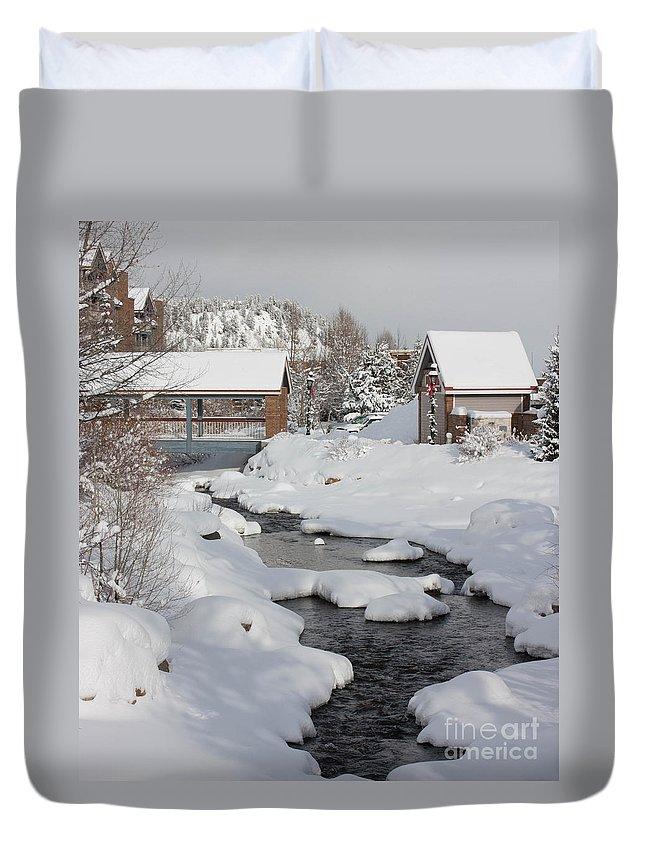 Landscape Duvet Cover featuring the photograph River Flowing Under A Bridge by Greg Plamp