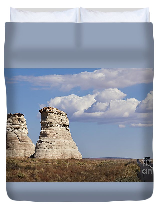 America Duvet Cover featuring the photograph Rocky Buttes Protrude From The Middle Of Arizona Landscape by B Christopher