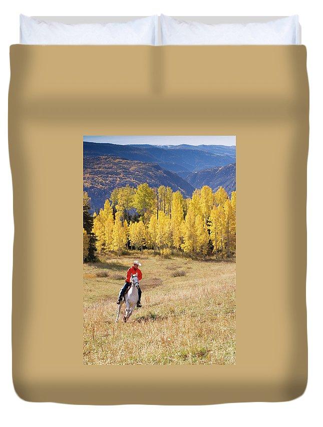 San Juan Mountains Duvet Cover featuring the photograph Rocky Mountain Cowboy by Amygdala imagery