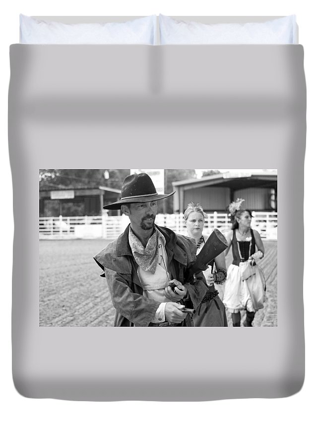Rodeo Duvet Cover featuring the photograph Rodeo Gunslinger With Saloon Girls Bw by Sally Rockefeller