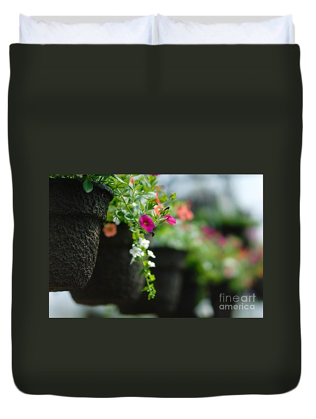 Floral Arrangement Duvet Cover featuring the photograph Row Of Hanging Baskets Shallow Dof by Amy Cicconi