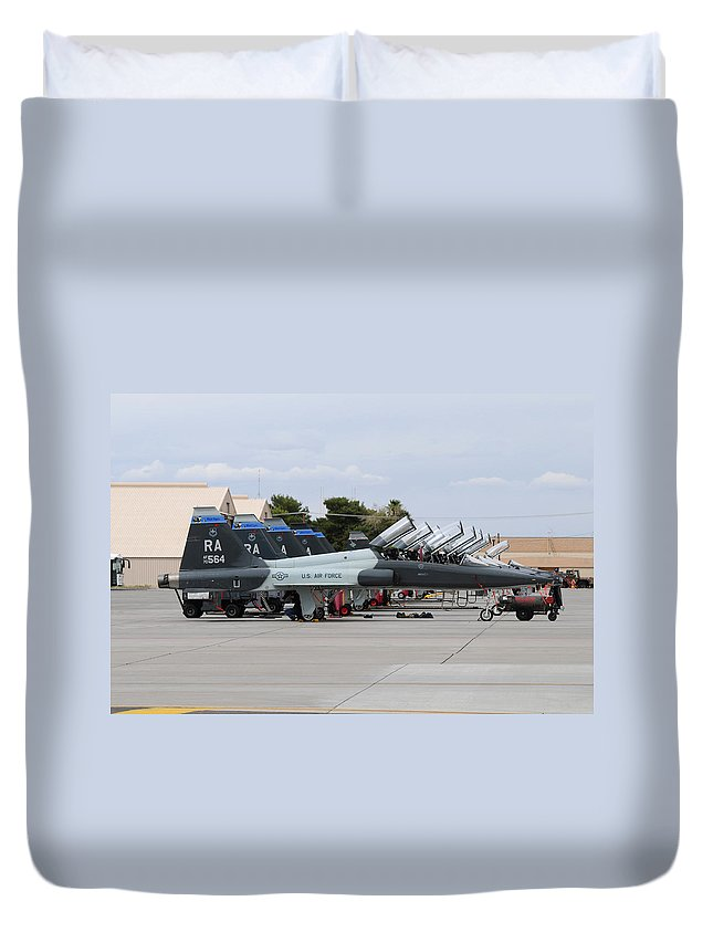 Nellis Air Force Base Duvet Cover featuring the photograph Row Of T-38c Trainer Jets At Nellis Air by Riccardo Niccoli