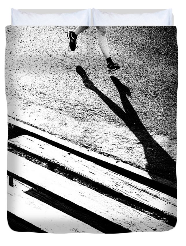 Runner Duvet Cover featuring the photograph Runner's Shadow by Caitlyn Grasso
