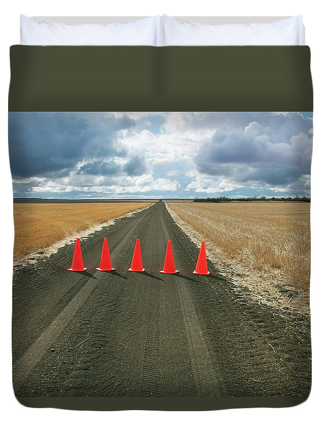 Orange Color Duvet Cover featuring the photograph Safety Cones Lined Up Across A Rural by Benjamin Rondel / Design Pics