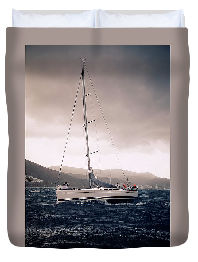 Recreational Pursuit Duvet Cover featuring the photograph Sailing And Stormy Weather by Travenian