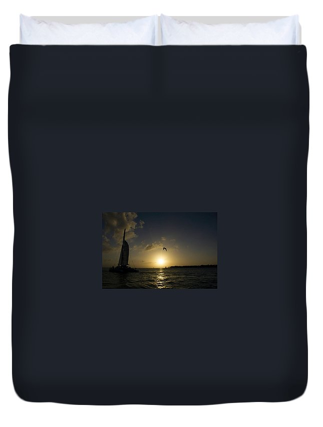 Sail Duvet Cover featuring the photograph Sailing At Sunset by Kathleen Odenthal