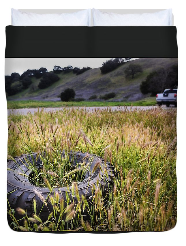 Tire Duvet Cover featuring the photograph Second Thoughts by Caitlyn Grasso