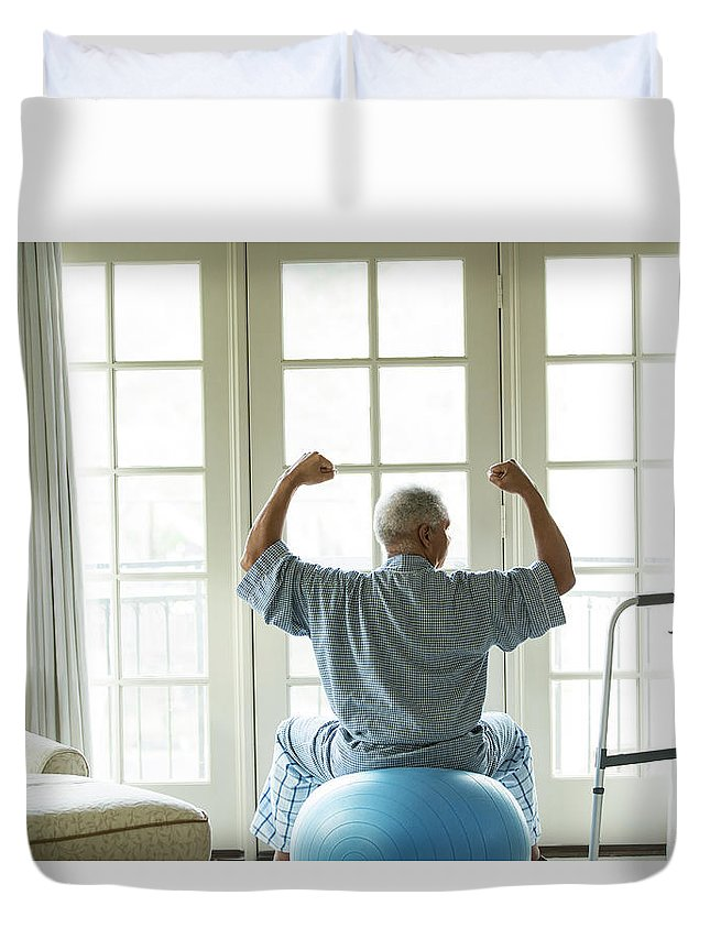 Human Arm Duvet Cover featuring the photograph Senior African American Man On Fitness by Tvp Inc