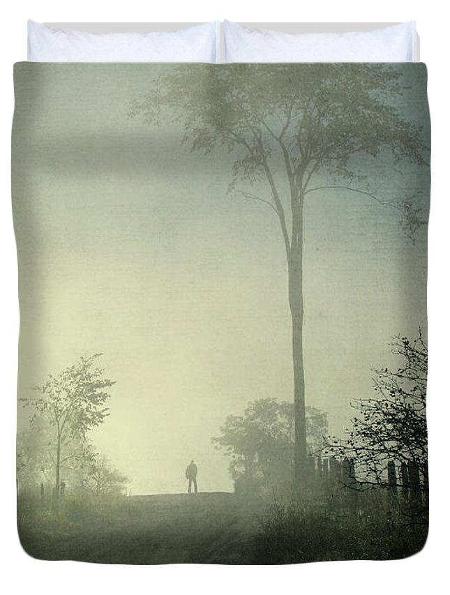 Tranquility Duvet Cover featuring the photograph Silhouette Of A Man In Fog by Francois Dion