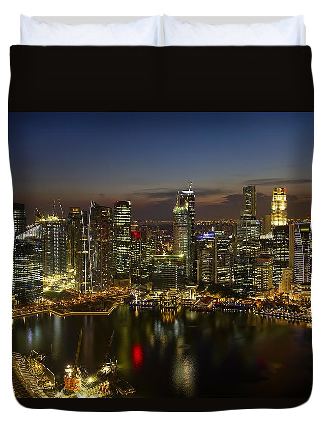 Singapore Duvet Cover featuring the photograph Singapore City Skyline At Dusk by David Gn
