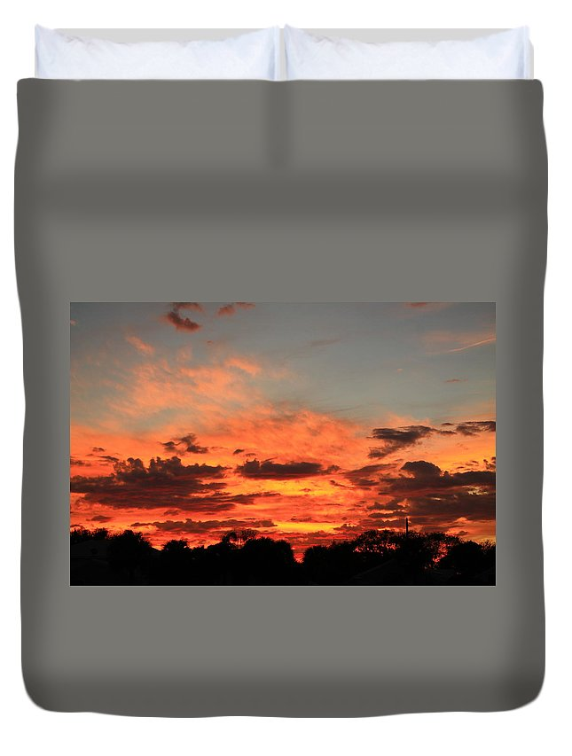 Sunset Duvet Cover featuring the photograph Sky Flames by Catie Canetti
