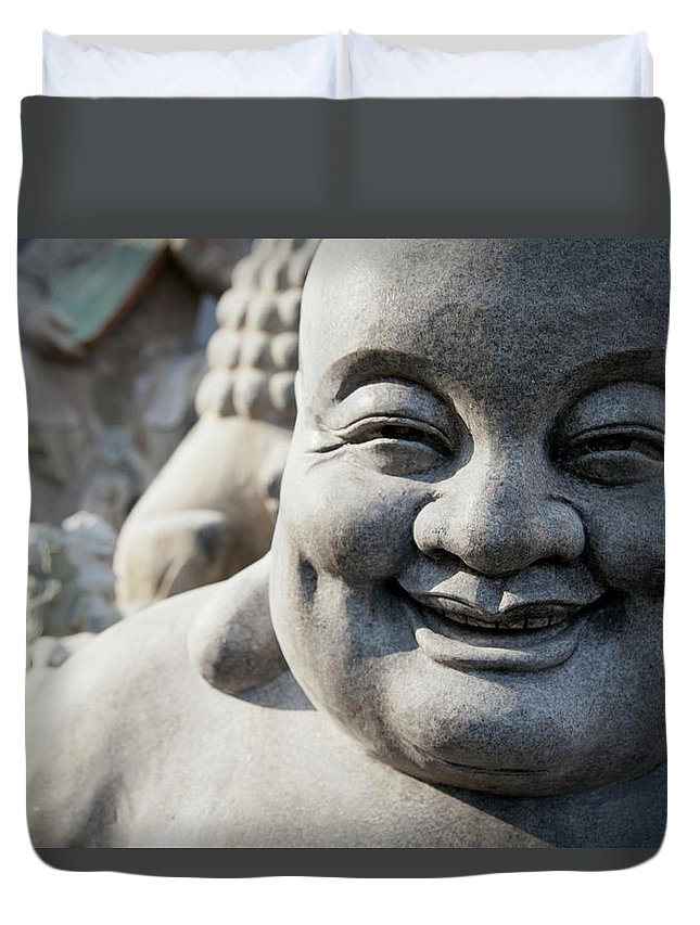 Chinese Culture Duvet Cover featuring the photograph Smiling Stone Buddha Statue by Blake Kent / Design Pics