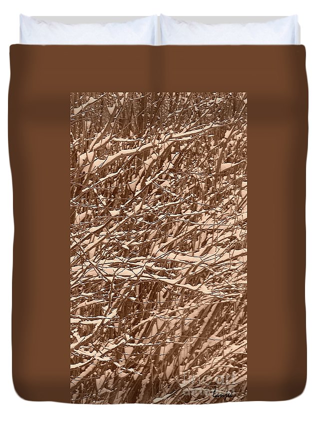 Backdrop Duvet Cover featuring the photograph Snow Covers A Tree Branch In Winter by Jeelan Clark