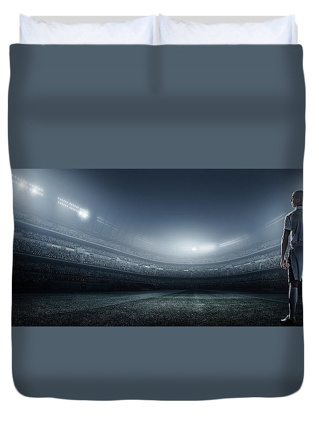 Soccer Uniform Duvet Cover featuring the photograph Soccer Player With Ball In Stadium by Dmytro Aksonov