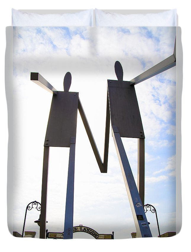 South Duvet Cover featuring the photograph South Street Stick Men Statue by Bill Cannon